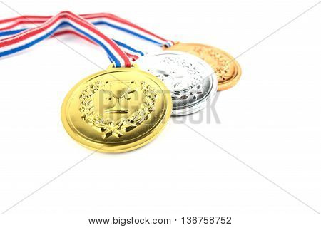 Gold silver and bronze medals with trophy symbol on white background
