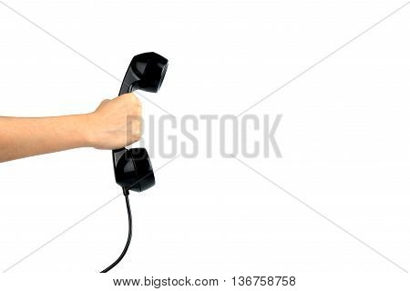 Hand holding vintage phone isolated on white with clipping path