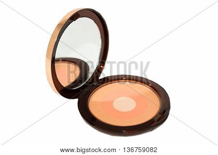 Cosmetic three-colored round blush isolated on white background.