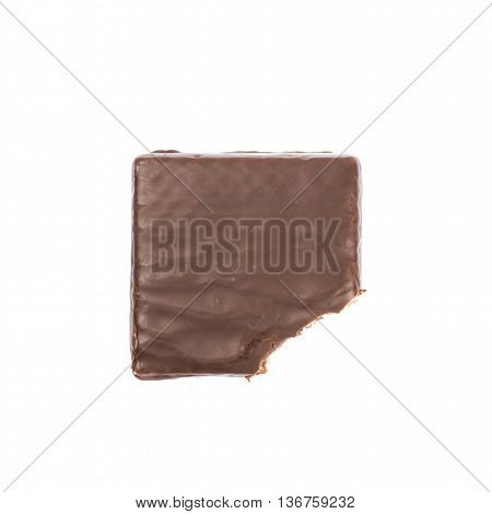 Chocolate waffle candy bar, bitten, composition isolated over the white background