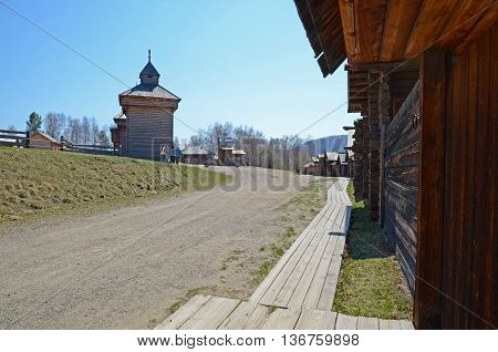 Irkutsk regionRU-May10 2015: Village street in the outdoor Museum of Wooden Architecture Taltsy, Russian parish