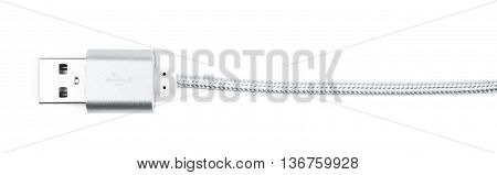 Close-up fragment of the silver metal USB cable isolated over the white background