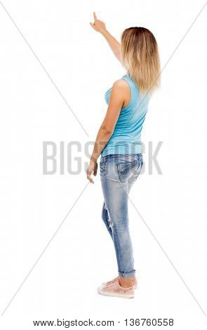 Back view of  pointing woman. beautiful girl. Rear view people collection.  backside view of person. Isolated over white background. girl in jeans and blue t-shirt standing and shows his left hand up