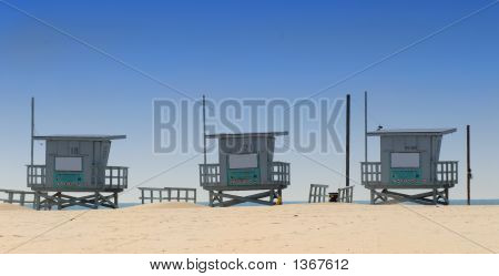 Three Lifeguard Shacks On Venice Beach, California