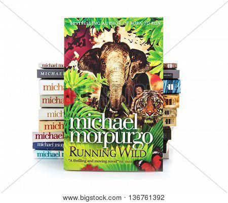 SWINDON UK - JULY 11 2016: Running Wild by Michael Morpurgo on a white background