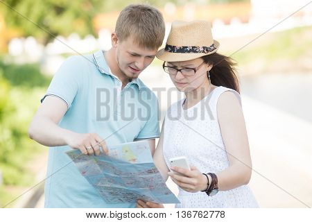 Traveling Couple With Map And Phone Got Lost On A Trip