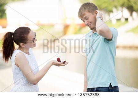 A Woman Making Proposal To Boyfriend