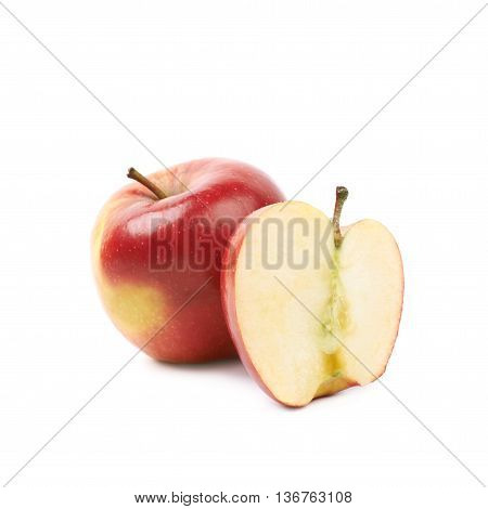 Single ripe red and golden jonagold apple next to a slice, composition isolated over the white background
