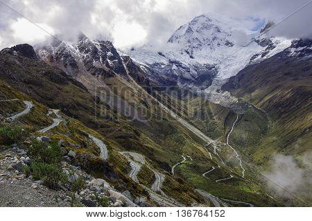 Mountain Pass In Huascaran National Park, With Huascaran Mount At Background. Cordillera Blanca. Per