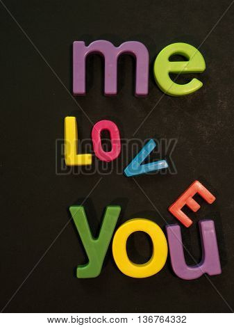 Love is falling apart message in vibrant colorful magnet letters