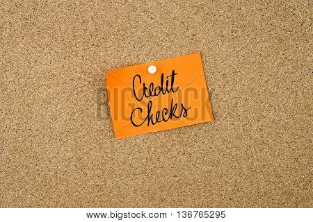 Credit Checks Written On Orange Paper Note