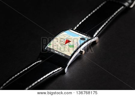 modern technology, navigation, location, object and media concept - close up of black smart watch with gps navigator map on screen
