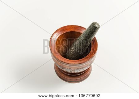 wood mortar and rock pestle isolated on white backgorund