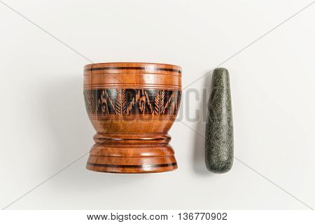 top view wood mortar and rock pestle isolated on white backgorund