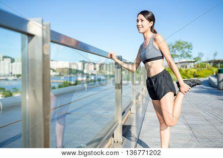 Woman stretching legs before run