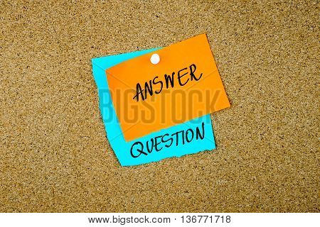 Answer Question written on paper notes pinned on cork board with white thumb tack copy space available