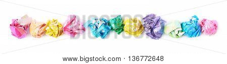 Line made of colorful crumbled origame paper sheet balls isolated over the white background