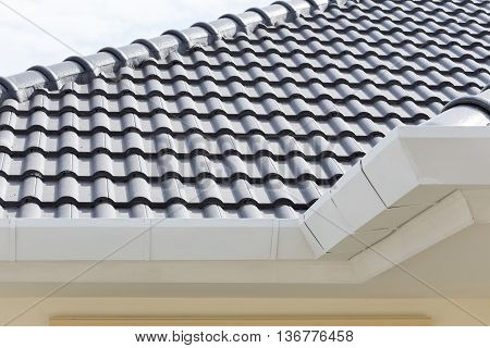 White Gutter On The Roof Top Of House