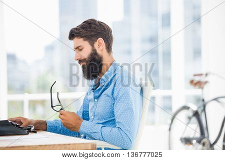 Hipster using type writer in an office