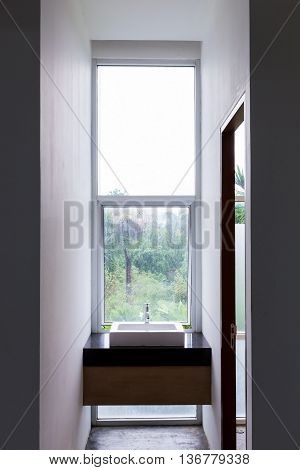 Washbasin In Bathroom With Transparent Mirror Window Nature View