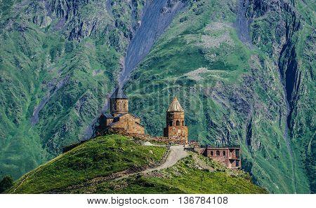 Gergeti Georgia - July 20 2015. One of the foremost Georgian landmarks - Tsminda Sameba church (english: Holy Trinity) near Gergeti town