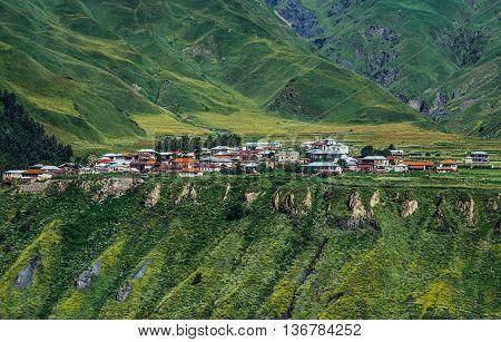 Caucasus Mountains Georgia - July 21 2015. Small village seen from so called Georgian Military Higway through Caucasus Mountains