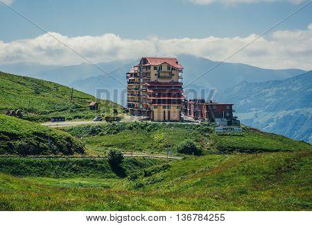 Guduari Georgia - July 21 2015. Large hotel in Guguari town seen from so called Georgian Military Higway through Caucasus Mountains