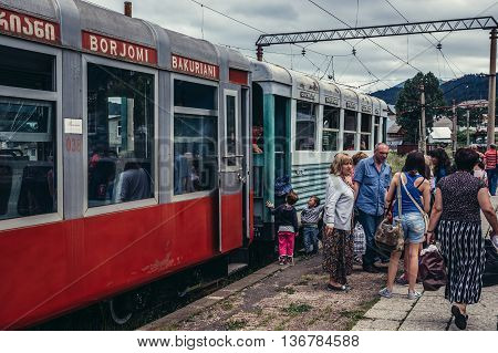 Bakuriani Georgia - July 22 2015. Passengers on Bakuriani station of Borjomi-Bakuriani narrow gauge railway known as