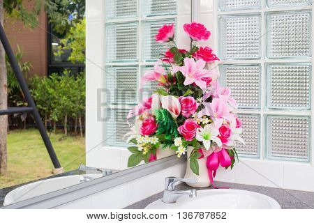 Vase Of Artificial Flower In The Bathroom