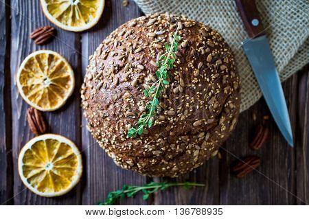 freshly baked multigrain bread on rustic background