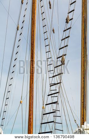Some Climbing ladders up tall ships masts