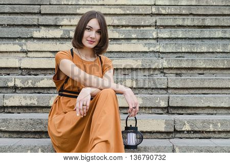 Beautiful Girl Sitting On Stairs