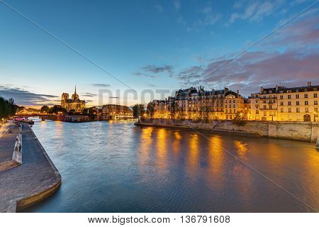 The river Seine with the Ile de la Cite and the Notre Dame Cathedral in Paris at dawn