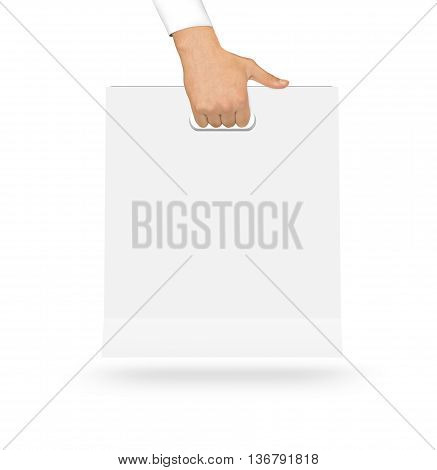 Blank white paper bag mock up holding in hand. Empty plastic package mockup hold in hands isolated on white. Consumer pack ready for logo design or identity presentation. Product packet handle.