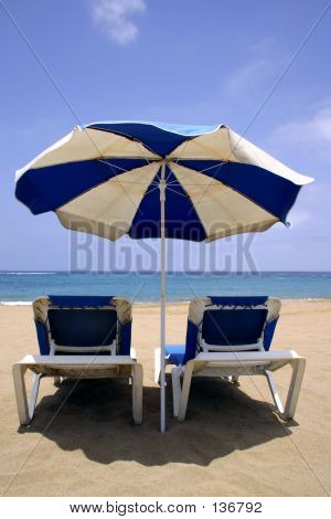 Beach Umbrella And Beds