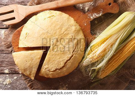 Homemade Healthy Corn Bread Close-up On A Wooden Board. Horizontal Top View
