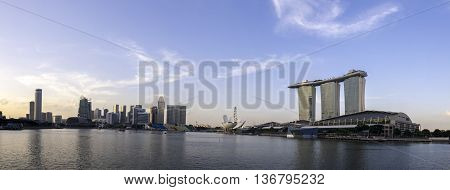 Sunset panorama view of Singapore skyline over a clear blue sky