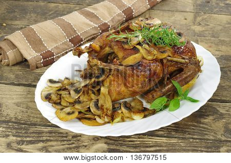 whole roast honey duck on white plate