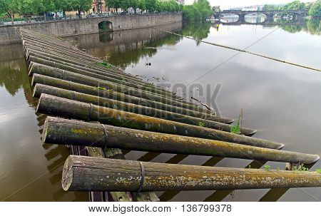 Wooden barriers on the river bridge in the background