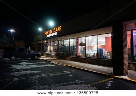 JOLIET, ILLINOIS / UNITED STATES - NOVEMBER 23, 2015: One may purchase food, tobacco and liquor during the night at the Pantry Lane, in the Crossroads Plaza.