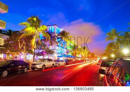 Miami Beach South Beach sunset in Ocean Drive Florida Art Deco and car lights