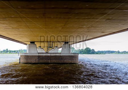 The Moerdijk road bridge built in 1976 part of the A16 motorway over the Dutch Hollands Diep river is the connection between the province of North Brabant and the Island of Dordrecht in the province of South Holland.