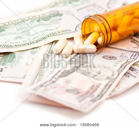 Pills and Dollars isolated on white background