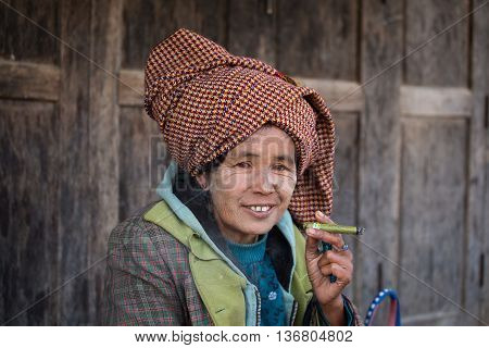 INLE LAKE MYANMAR - JANUARY 13 2016: Unidentified old woman on her smile face is happiness. The local people are hospitable and friendly to tourists