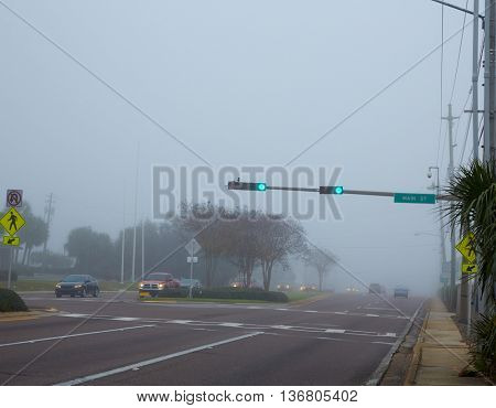 Foggy haze morning in Florida with traffic cars USA