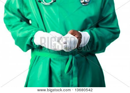 Senior Surgeon putting on his gloves before surgery