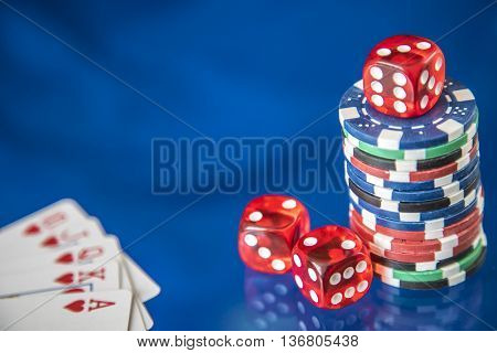 Gambling chips frame and card for poker on blue mirror background