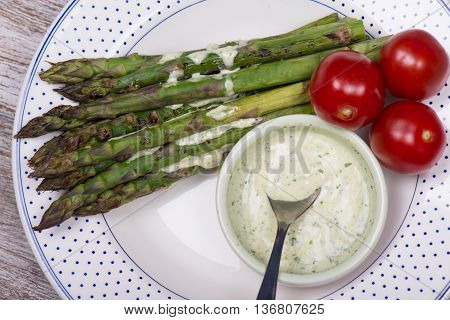 Baked green asparagus, cherry tomato and dragon mayonaise