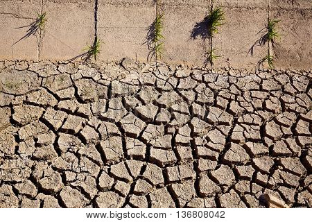 Dried irrigation ditch clay soil in Albufera rice fields of Valencia
