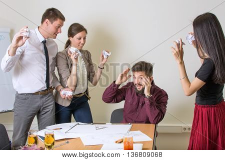 People Throwing Papers On A Colleague